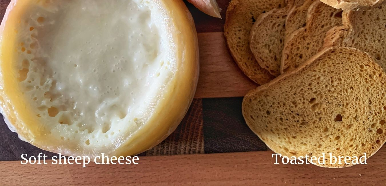 soft cheese and slices of toasted bread